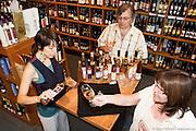 Julie-Drouin serving apple ice cider at Marché des Saveurs boutique located in Marché Jean-Talon in Little Italy / La Petite Italie, Montréal, Québec, Canada, 2008 08 20. © Photo Marc Gibert / adecom.ca