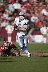 Dec 27, 2009; San Francisco, CA, USA;  Detroit Lions quarterback Drew Stanton (5) breaks a tackle from San Francisco 49ers linebacker Patrick Willis (52) during the first quarter at Candlestick Park. San Francisco defeated Detroit 20-6.