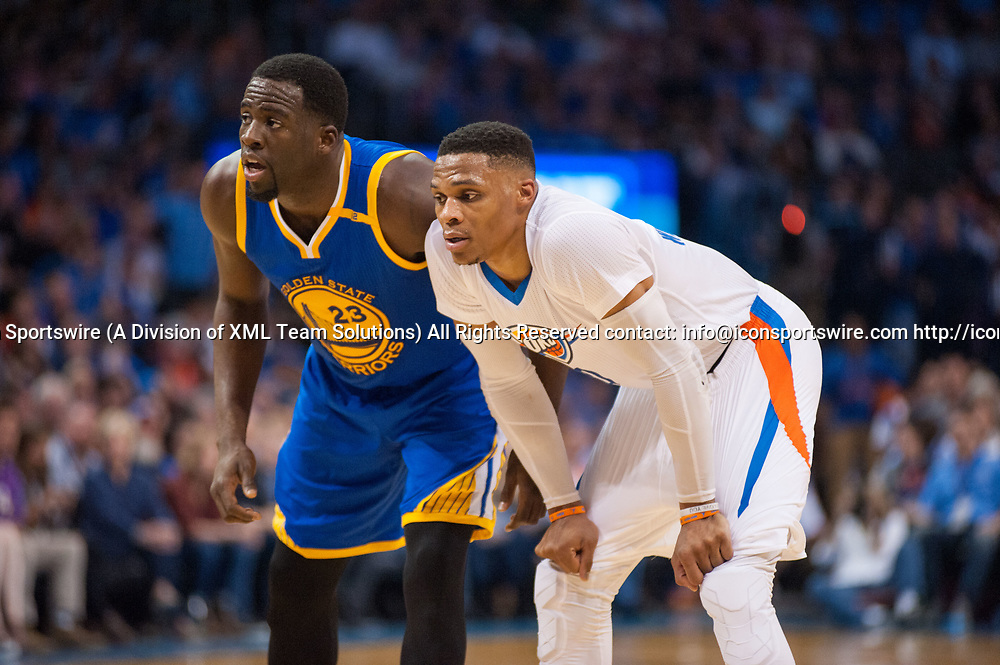 OKLAHOMA CITY, OK - MARCH 20:   Golden State Warriors Forward Draymond Green (23) and Oklahoma City Thunder Guard Russell Westbrook (0) in game on March 20, 2017, at the Chesapeake Energy Arena Oklahoma City, OK. (Photo by Torrey Purvey/Icon Sportswire)