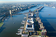 Nederland, Noord-Holland, Amsterdam, 11-12-2013; KNSM-eiland  gezien naar Verbindingsdam en Java-eiland. Links water van de Ertshaven met Levantkade en Barcelonaplein (met rond gebouw). Rechts Surinamekade.<br /> Overview newly developed former harbor area.<br /> luchtfoto (toeslag op standaard tarieven);<br /> aerial photo (additional fee required);<br /> copyright foto/photo Siebe Swart.