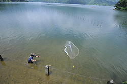 July 29, 2017 - Pokhara, NP, Nepal - A Nepalese fisherman casting a net for catching freshwater fish at Begnas Lake, Pokhara, Nepal on Saturday, July 29, 2017. (Credit Image: © Narayan Maharjan/NurPhoto via ZUMA Press)
