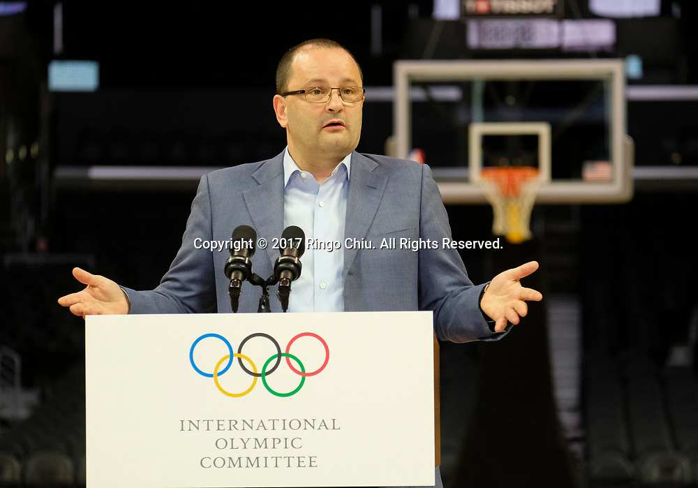 International Olympic Committee Evaluation Commission Chair Patrick Baumann speaks during a news conference at Staples Center, Friday, May 12, 2017, in Los Angeles. The IOC officials wrapped up four days of evaluating Los Angeles' bid for the 2024 Games before heading to Paris to check the only other candidate.(Photo by Ringo Chiu/PHOTOFORMULA.com)<br /> <br /> Usage Notes: This content is intended for editorial use only. For other uses, additional clearances may be required.