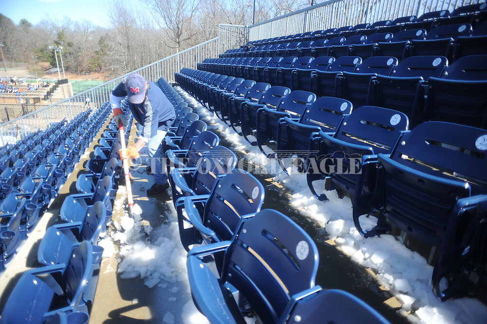 Ole Miss employee Tommy Parker clears ice from the stands during the game at Stetson at Oxford-University Stadium in Oxford, Miss. on Saturday, March 7, 2015. Ole Miss won 8-3 in game 1 of a doubleheader to improve to 7-5.