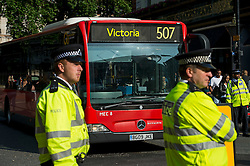 © Licensed to London News Pictures. 09/07/2015. London, UK. Police presence at Victoria Station. Commuters stranded at Victoria Station in London on the day of a network wide tube strike which finishes at 9.30 this evening. Photo credit: Ben Cawthra/LNP