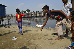 October 23, 2016 - Dhaka, Bangladesh - A group of Bangladeshi slum children are playing marble at Rayer Bazar slum in Dhaka city, Bangladesh on October 23, 2016...Bangladeshi slum child at Rayer Bazar slum in Dhaka. More than half of the populations of city slums are children. They face hardship on a daily basis that includes hunger, poor access to clean water, health care, insufficient education and protection. (Credit Image: © Str/NurPhoto via ZUMA Press)