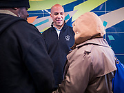27 NOVEMBER 2019 - DES MOINES, IOWA: US Senator CORY BOOKER (D-NJ) talks to clients at Central Iowa Shelter and Services in Des Moines. Sen Booker helped plate up and serve lunch at the shelter. The shelter has about 180 beds and is full almost every night. In January and February, more than 250 people per night come to the shelter, which sets out overflow bedding. Senator Booker is running to be the Democratic nominee for the US Presidency in 2020. Iowa hosts the first selection event of the presidential election season. The Iowa caucuses are February 3, 2020.       PHOTO BY JACK KURTZ