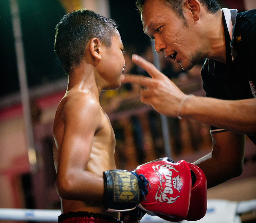 Fighting back the tears, a young Muay Thai fighter is given a standing 8 count. When the referee saw the boy's tears the he immediately stopped the contest. A wise decision. Nakhon Nayok Thailand.