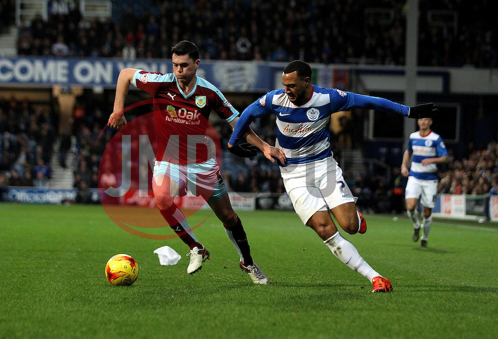 Michael Keane of Burnley and Matt Phillips of Queens Park Rangers battle for the ball - Mandatory byline: Robbie Stephenson/JMP - 12/12/2015 - Football - Loftus Road - London, England - Queens Park Rangers v Burnley  - Sky Bet Championship