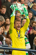 Celtic Keeper Scott Bain holds the William Hill Scottish Cup aloft following their victory today in the William Hill Scottish Cup Final match between Heart of Midlothian and Celtic at Hampden Park, Glasgow, United Kingdom on 25 May 2019.