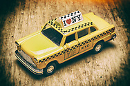 London, England - June 09, 2017: New York City Yellow Taxi Model Car, The old fashioned Checker Cab, Checker Cabs were the most popular in New York