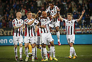 Onderwerp/Subject: Eredivisie<br /> Reklame:  <br /> Club/Team/Country: <br /> Seizoen/Season: 2012/2013<br /> FOTO/PHOTO: Philipp HAASTRUP (R) of Willem II celebrating his goal with Tim CORNELISSE (L) of Willem II and Danny GUIJT (C) of Willem II and Virgil MISIDJAN (RR) of Willem II ( 1 - 0 ). (Photo by PICS UNITED)<br /> <br /> Trefwoorden/Keywords: <br /> #02 $94 ±1355242121502 ±1355242121502<br /> Photo- & Copyrights © PICS UNITED <br /> P.O. Box 7164 - 5605 BE  EINDHOVEN (THE NETHERLANDS) <br /> Phone +31 (0)40 296 28 00 <br /> Fax +31 (0) 40 248 47 43 <br /> http://www.pics-united.com <br /> e-mail : sales@pics-united.com (If you would like to raise any issues regarding any aspects of products / service of PICS UNITED) or <br /> e-mail : sales@pics-united.com   <br /> <br /> ATTENTIE: <br /> Publicatie ook bij aanbieding door derden is slechts toegestaan na verkregen toestemming van Pics United. <br /> VOLLEDIGE NAAMSVERMELDING IS VERPLICHT! (© PICS UNITED/Naam Fotograaf, zie veld 4 van de bestandsinfo 'credits') <br /> ATTENTION:  <br /> © Pics United. Reproduction/publication of this photo by any parties is only permitted after authorisation is sought and obtained from  PICS UNITED- THE NETHERLANDS