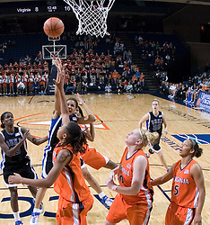 Duke Blue Devils Guard Lindsey Harding (10)shoots over Virginia Cavaliers Forward Lyndra Littles (1).  The University of Virginia Cavaliers lost to the #1 ranked Duke University Blue Devils 76-61 at the John Paul Jones Arena in Charlottesville, VA on February 2, 2007.