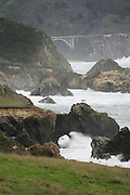 CALIFORNIA COAST - JANUARY 2:  2006 Waves crash on the beach as the rocks form arches in the Monterey Peninsula during New Year's vacation driving along the California Coast on January 2, 2006. ©Paul Anthony Spinelli