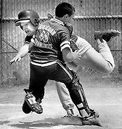 A collision at home plate during a Little League game in Cornwall, New York.