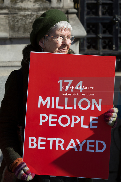 On the day that MPs in Parliament vote on a possible delay on Article 50 on EU Brexit negotiations by Prime Minister Theresa May, a Brexiteer activist protests outside the House of Commons, on 14th March 2019, in Westminster, London, England.