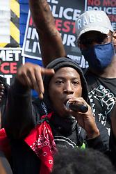 © Licensed to London News Pictures. 08/08/2020. London, UK. The leader of Forever Family Force - Khari McKenzie talks to Black Lives Matter protestors outside Tottenham Police Station in north London. Photo credit: Marcin Nowak/LNP