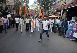 April 5, 2017 - Kolkata, West Bengal, India - Hindu activist perform different sword act during the rally on occasion of Rama Navami in Kolkata.Hindu devotees gather in aprocesion organized by Hindu Jagaran Manch on the occasion of Rama Navami festival in Burrabazzar area of Kolkata. Rama Navami is a Hindu festival that celebrates the birthday of God Rama. (Credit Image: © Saikat Paul/Pacific Press via ZUMA Wire)