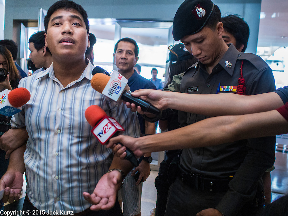 "14 FEBRUARY 2015 - BANGKOK, THAILAND: Student activist Siriwit Serithiwat talks to reporters after he was detained by police during a protest the military coup. Martial law is still in effect in Thailand and protests against the coup are illegal. Dozens of people gathered in front of the Bangkok Art and Culture Centre in Bangkok Saturday to hand out red roses and copies of George Orwell's ""1984."" Protestors said they didn't support either Red Shirts or Yellow Shirts but wanted a return of democracy in Thailand. The protest was the largest protest since June 2014, against the military government of General Prayuth Chan-Ocha, who staged the coup against the elected government. Police made several arrests Saturday afternoon but the protest was not violent.      PHOTO BY JACK KURTZ"