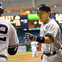 New York Yankees Hideki Matsui, of Japan,  right, is congratulated by teammate Robinson Cano after hitting a home run off of Tampa Bay Devil Rays pitcher Doug Waechter during the second inning of their American League baseball game on Thursday, May 4, 2006 in St. Petersburg, Fla.(AP Photo/Scott Audette)