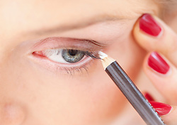 Close-up View of Woman Using Eye Pencil