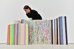 """© Licensed to London News Pictures. 13/09/2017. London, UK. A woman views """"Scrolls"""" by Mit Jai Inn.  Preview of the START Art Fair at the Saatchi Gallery in Chelsea.  The fair showcases the best emerging artists from developing markets across the globe and is open to the public 14 to 17 September. Photo credit : Stephen Chung/LNP"""