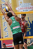 STARE JABLONKI POLAND - July 5: Clemens Doppler of Austria and Juan Virgen of Mexico in action during Day 5 of the FIVB Beach Volleyball World Championships on July 5, 2013 in Stare Jablonki Poland.  (Photo by Piotr Hawalej)