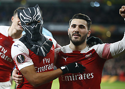 March 14, 2019 - London, England, United Kingdom - Pierre-Emerick Aubameyang of Arsenal celebrate with a mask and \with Dead Kolasinac of Arsenal.during Europa League Round of 16 2nd Leg  between Arsenal and Rennes at Emirates stadium , London, England on 14 Mar 2019. (Credit Image: © Action Foto Sport/NurPhoto via ZUMA Press)