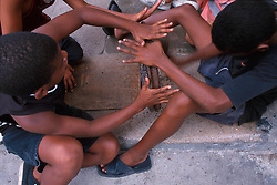 Children try to repair a bicycle wheel in the streets of Havana, Cuba. (Photo © Jock Fistick)