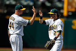 OAKLAND, CA - APRIL 17:  Ryan Madson #44 of the Oakland Athletics celebrates with Josh Reddick #22 after the game against the Kansas City Royals at the Oakland Coliseum on April 17, 2016 in Oakland, California.  The Oakland Athletics defeated the Kansas City Royals 3-2. (Photo by Jason O. Watson/Getty Images) *** Local Caption *** Ryan Madson; Josh Reddick