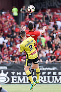 February 12, 2017: Western Sydney Wanderers midfielder Kearyn BACCUS (15) goes up for the ball with Central Coast Mariners forward Roy O'DONOVAN (9) at Round 19 of the 2017 Hyundai A-League match, between Western Sydney Wanderers and Central Coast Mariners played at Spotless Stadium in Sydney.