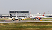 Airplanes ready for takeoff at Malpensa airport, Milan, Italy