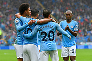 Goal - Sergio Aguero (10) of Manchester City celebrates scoring a goal to give a 0-1 lead to the away team with Leroy Sane (19) of Manchester Cityand Bernardo Silva (20) of Manchester City during the Premier League match between Cardiff City and Manchester City at the Cardiff City Stadium, Cardiff, Wales on 22 September 2018.