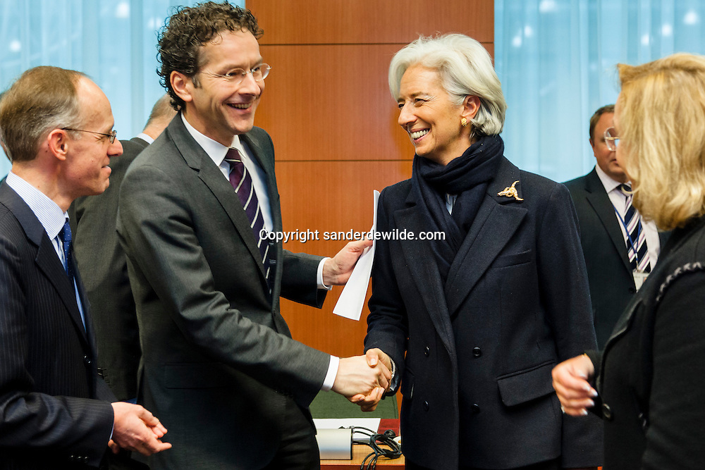 (From L) Luxembourg's Finance Minister Luc Frieden looks on as Dutch Finance Minister and President of the Eurogroup Council Jeroen Dijsselbloem salutes International Monetary Fund (IMF) Managing Director Christine Lagarde before an Eurogroup Council meeting on February 11, 2013 at the European Union Headquarters in Brussels. Dijsselbloem holds his first eurozone meeting today, with Cyprus and Greece on the agenda.