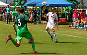 Canada midfielder Mael Henry (10) receives a pass while Slovenia defenders Peter Ceferin (3) and Jemej Belinc (2) run in to pressure the ball during a CONCACAF boys under-15 championship soccer game, Saturday, August 10, 2019, in Bradenton, Fla. Slovenia defeated Canada in 2-1 in overtime and advanced to the finals against Portugal. (Kim Hukari/Image of Sport)