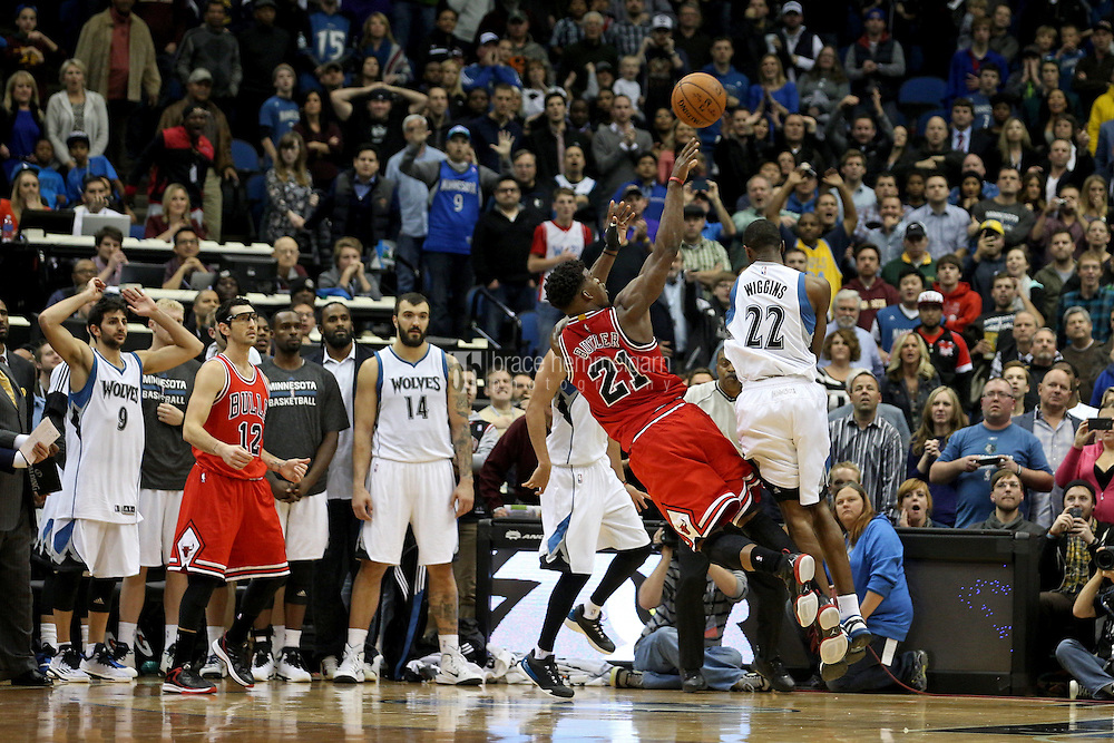 Nov 1, 2014; Minneapolis, MN, USA; Minnesota Timberwolves guard Andrew Wiggins (22) fouls Chicago Bulls guard Jimmy Butler (21) during the fourth quarter at Target Center. The Bulls defeated the Timberwolves 106-105. Mandatory Credit: Brace Hemmelgarn-USA TODAY Sports