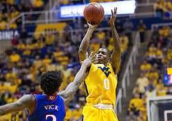Jan 24, 2017; Morgantown, WV, USA; West Virginia Mountaineers guard Teyvon Myers (0) shoots a three pointer during the second half against the Kansas Jayhawks at WVU Coliseum. Mandatory Credit: Ben Queen-USA TODAY Sports