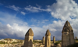Cappadocian pillars against an afternoon blue sky with clouds, Turkey