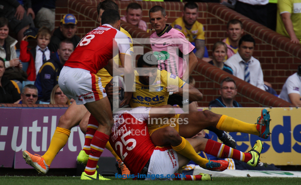 Kallum Watkins (R) of Leeds Rhinos tackled by Vincent Duport and Daryl Millard (L) of Catalans Dragons during the First Utility Super League match at Headingley Carnegie Stadium, Leeds<br /> Picture by Stephen Gaunt/Focus Images Ltd +447904 833202<br /> 29/06/2014