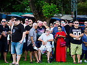 "11 NOVEMBER 2018 - KANCHANABURI, KANCHANABURI, THAILAND: People at the Rememberance Day ceremony at the Kanchanaburi War Cemetery in Kanchanaburi, Thailand. Kanchanaburi is the location of the infamous ""Bridge On the River Kwai"" and was known for the ""Death Railway"" built by Japan during World War II using allied, principally British, Australian and Dutch, prisoners of war as slave labor. There are 6,982 people buried in the cemetery, including 5,000 Commonwealth soldiers and 1,800 Dutch soldiers. November 11, 2018 marked the 100th anniversary of the end of World War I, celebrated as Rememberance Day in the UK and the Commonwealth and Veterans' Day in the US.     PHOTO BY JACK KURTZ"