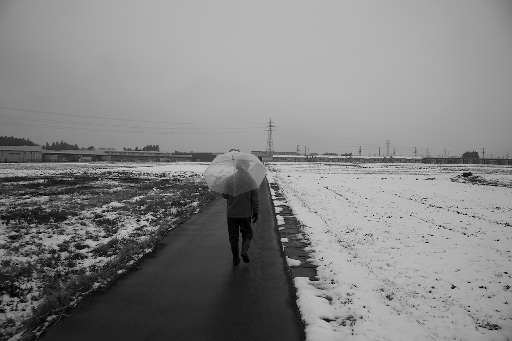 walking home toward New Tempoary housing complex built for evacuees in  Minami Soma
