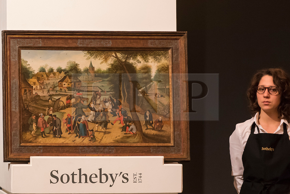 "© Licensed to London News Pictures. 07/12/2016. London, UK. ""Return from the Kermesse"" by Pieter Brueghel the Younger which sold for a hammer price of GBP2.15m (est. GBP 2-3m), at the Old Masters Evening Sale at Sotheby's in New Bond Street. Photo credit : Stephen Chung/LNP"