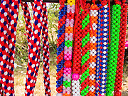08 FEBRUARY 2014 - PHAWONG, SONGKHLA, THAILAND: Decorative beads and halter ropes for fighting bulls for sale at a bullfight in Thailand. Bullfighting is a popular past time in southern Thailand. Hat Yai is the center of Thailand's bullfighting culture. In Thai bullfights, two bulls are placed in an arena and they fight, usually by head butting each other, until one runs away or time is called. Huge amounts of mony are wagered on Thai bullfights - sometimes as much as 2,000,000 Thai Baht ($65,000 US).   PHOTO BY JACK KURTZ
