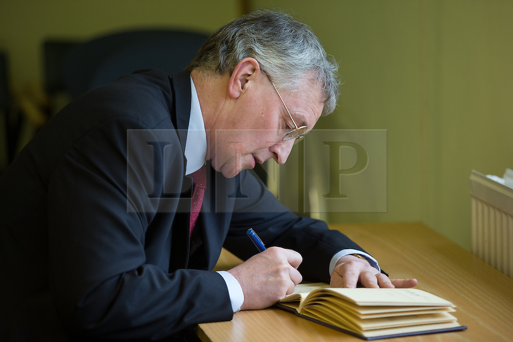 © Licensed to London News Pictures . 03/02/2014 . Manchester , UK . HILARY BENN signs a book of condolences in memory of Paul Goggins . Hilary Benn , MP for Leeds Central and Shadow Community Secretary for the Labour Party , joins Labour candidate Mike Kane on the campaign trail ahead of the Wythenshawe and Sale East by-election , following the death of MP Paul Goggins . The pair speak to local pensioners about communities and housing . Photo credit : Joel Goodman/LNP