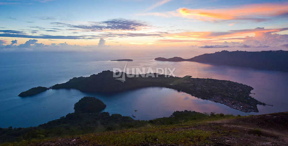 Sunrise view from the summit of Gunung Api, the volcano that forms the heart of the Banda Islands.