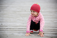 Madeline Chaney, age 2, checks out a honey bee on the dock at Newport Bay Harbor in Oregon