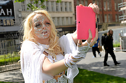 Pictured is 'Lucky Candy Kitten' dressed as Emma, taking a 'selfie'.<br /> <br /> X-men fans gather at London's Leicester Square to try and break the Guinness World Record for the most amount of X-men characters gathered together.<br /> <br /> Monday, 12th May 2014. Picture by Ben Stevens / i-Images