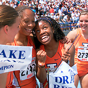 Des Moines, Drake Relays 2001 -- Perdita Felicien, second from right, anchored Illionis' women's shuttle hurdle relay team to a collegiate record of 52.85 seconds.  Felicien and her teammates, from left, Jenny Kallur, Camee' Williams and Susanna Kallur.  photo by David Peterson