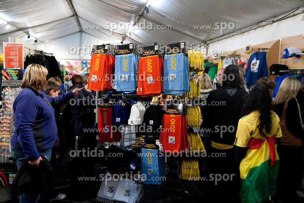 Fans at shopping in official fan shop  prior to the 2010 FIFA World Cup South Africa Quarter Finals football match between Uruguay and Ghana on July 02, 2010 at Soccer City Stadium in Sowetto, suburb of Johannesburg. (Photo by Vid Ponikvar / Sportida)