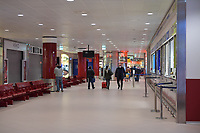 2020-03-13   BOLOGNA, ITALIA: A almost empty airport with people wearing protective mask due to the corona virus outbreak. ( Photo by: Wilfried Butin   Swe Press Photo )<br /> <br /> Keywords: BOLOGNA, CITY, CORONA VIRUS, AIRPORT, BOLOGNA, ITALY, wbbologna140320