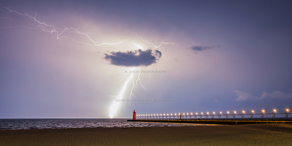 A freakishly large lightning bolt that turned night into day strikes off shore in South Haven, Michigan